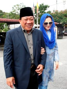 This photo taken on May 19, 2010 shows Malaysian lawmaker Bung Mokhtar Radin (L) and his second wife Zizie Ezette (R) arriving at a Shariah court in Kuala Lumpur. A Muslim lawmaker from Malaysia's ruling coalition was sentenced to a month in jail for polygamy on May 19 after he married an actress without permission from a religious court. Radin, 50, a leading figure in the Barisan Nasional coalition, and his second wife, Zizie Ezette A. Samad, 31, both pleaded guilty to polygamy last month.  AFP PHOTO (Photo credit should read AFP/AFP/Getty Images)